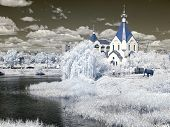 Church Ashore Lake. Temple Of All Saints In Earth Russian. Infrared Photo
