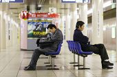 TOKYO,JAPAN, November 30 : two unidentified Japanese men sleeping in the subway waiting for the trai