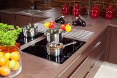 Black glass induction hob in the kitchen