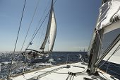 AEGEAN SEA, GREECE - APR 29, 2014: Unidentified sailors participate in sailing regatta
