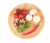 Fresh vegetables on wooden platter.
