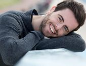 Charming Young Man Smiling Outdoors