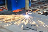 pic of laser beam  - Laser cutting of metal sheet with sparks - JPG