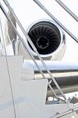 foto of jet  - Stairs with Jet Engine on a modern private jet airplane  - JPG