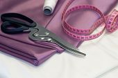 Large Dressmaking Scissors And Pink Measuring Tape