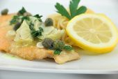 foto of artichoke hearts  - Delicious gourmet italian chicken picatta with noodles - JPG