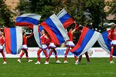 MOSCOW, RUSSIA - JUNE 29, 2014: Dancers with Russian flags supports the team Russia before the match