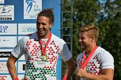 MOSCOW, RUSSIA - JUNE 29, 2014: Michael Ellery (left) and the team captain Tom Mitchell of England during award ceremony of the FIRA-AER European Grand Prix Series. England won gold medals