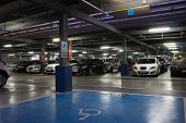 VALENCIA, SPAIN - JUNE 26, 2014: Inside the parking garage at the Valencia airport.  Situated 8 km f