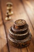 Vintage brass kitchen  weights on old wooden table