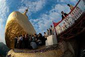 People Offerings Of Gold For Kyaiktiyo Pagoda.