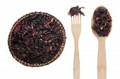 Dried Hibiscus  In A Plate, Fork And Spoon