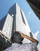 Man Looking At Skyscraper