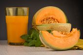 pic of honeydew melon  - Honeydew melon juice on a wooden table background - JPG