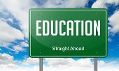 Education on Green Highway Signpost.