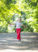 Little girl running in park