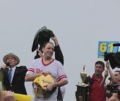 Seven time winner Joey Chestnut with belt