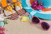 Sandals, Blue Heat And Pink Sunglasses On The Sand. Summer Beach Concept