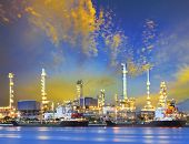 BANGKOK THAILAND - july3 : beautiful lighting on dusky sky of Bangchak oil refinery beside Chaopraya