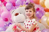 Image of joyful little girl posing in playroom