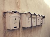 Old mailboxes on a wall