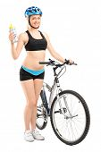 Full length portrait of a female cyclist holding a water bottle isolated on white background