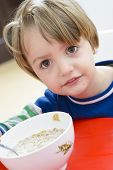 Boy Eating Cereal With Milk