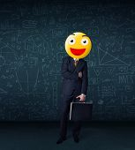 Funny businessman wears yellow smiley face