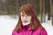 Charming Red-haired Girl In Winter Wood