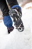 Hiker Walking On Snow In Winter Forest