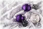 Luxury Christmas balls Silver pine cones on white satin . Christmas decoration.