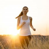 Young Beautiful Woman Running on the Trail in the Morning. Active Lifestyle