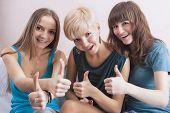 Three Nice Firl With Teeth Brackets Showing Thumbs Up Sign.