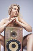 Sexy Seducing Caucasian Female With Loudspeaker