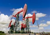 stock photo of jacking  - oil pump jacks on a oil field  - JPG