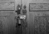 Old Wooden Door Locked With Padlock