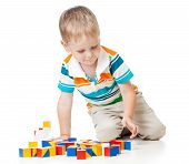 kid playing toy blocks  isolated