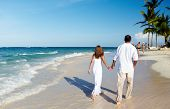 Romantic loving couple walking on the beach. Caribbean vacation.