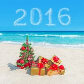 Christmas Tree And Golden Gifts At Sea Beach. Concept For New Year 2016