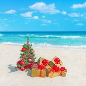 Christmas Tree And Golden Gifts At Tropical Ocean Beach