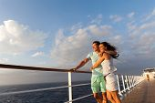 loving married couple standing on cruise deck enjoying sunset together