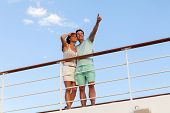low angle view of couple relaxing outdoors on cruise
