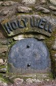 image of wishing-well  - Traditional well detail with Holy Well written over metal door - JPG