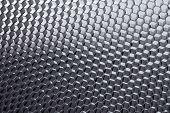 Honeycomb grid against grey background.