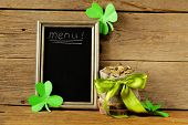 green clover leaves and a bag of gold - symbol of St. Patrick's Day