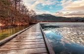 Boardwalk On Lake With Melting Ice