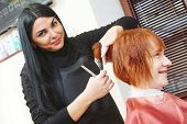 stock photo of beauty parlour  - Stylist cutting hair of a female client at the beauty salon - JPG