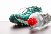 Sport shoe and a bottle of water closeup
