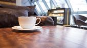 Coffee on table cafe interior background