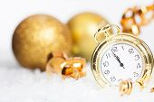 Old golden clock close to midnight and sparkling Christmas decoration - New Year concept